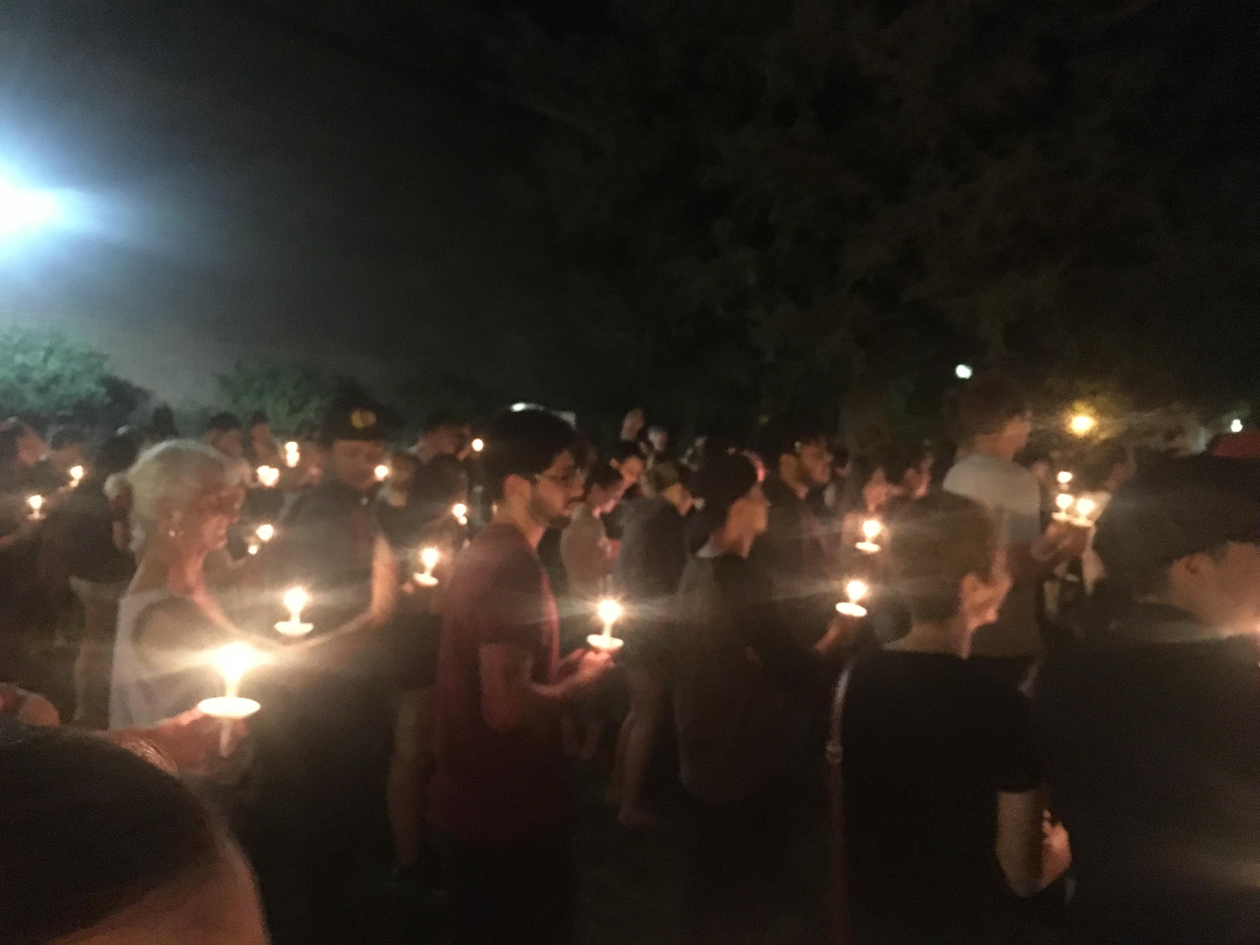 Gatherers at candlelight vigil. Photo credit: Kayla Fitzgerald