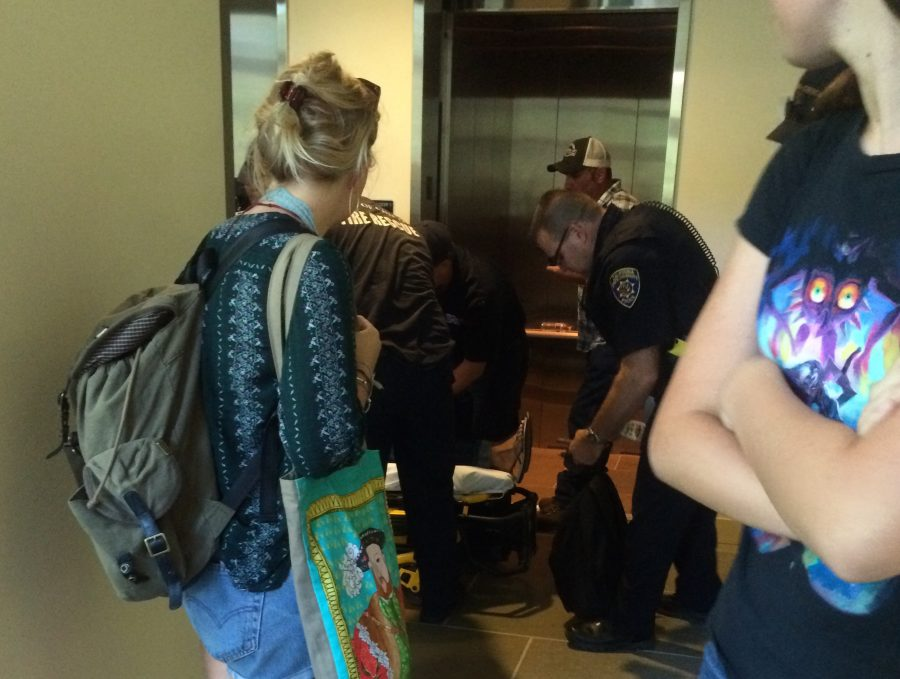 Girl being taken out of the elevator of the Student Services Center on a stretcher. Photo credit: Lexi Hoedt