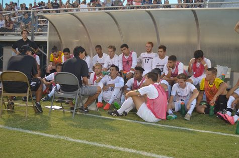 Men's soccer huddle_Web.jpg