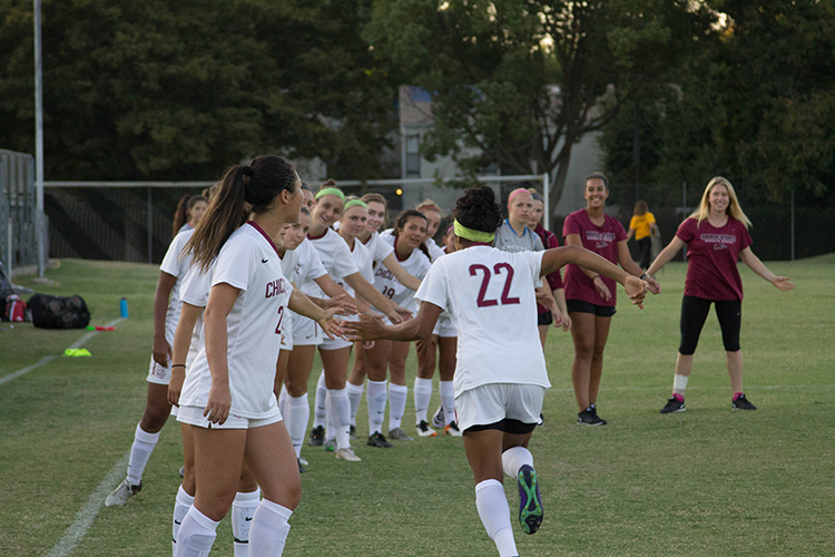 Junior+forward+Pooja+patel+is+greeted+by+her+teammates+as+she+takes+the+field.+Photo+credit%3A+Aubrie+Coley