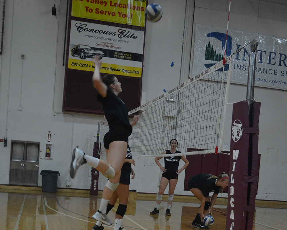 Chico State women's volleyball practices spiking before their game. Photo credit: Jordan Jarrell