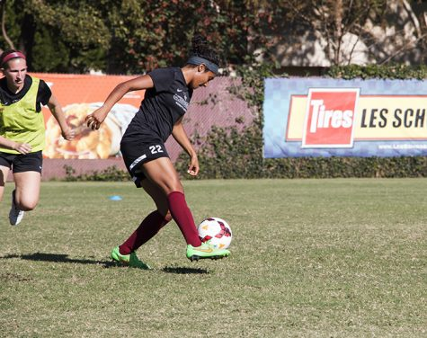 Pooja Patel keeps control of the ball during the 'Cats practice. Photo credit: Jenelle Kapellas