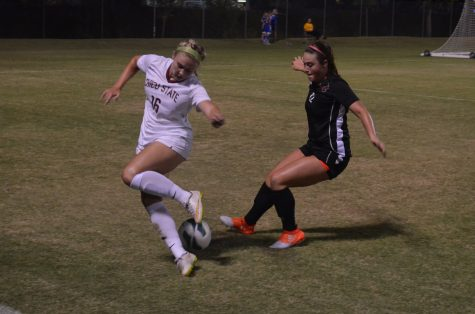 Chico State's Brianna Tovani battles for control of the ball Photo credit: Jordan Jarrell