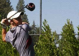 A Chico State golfer tees off during practice earlier this season. Photo credit: John Domogma