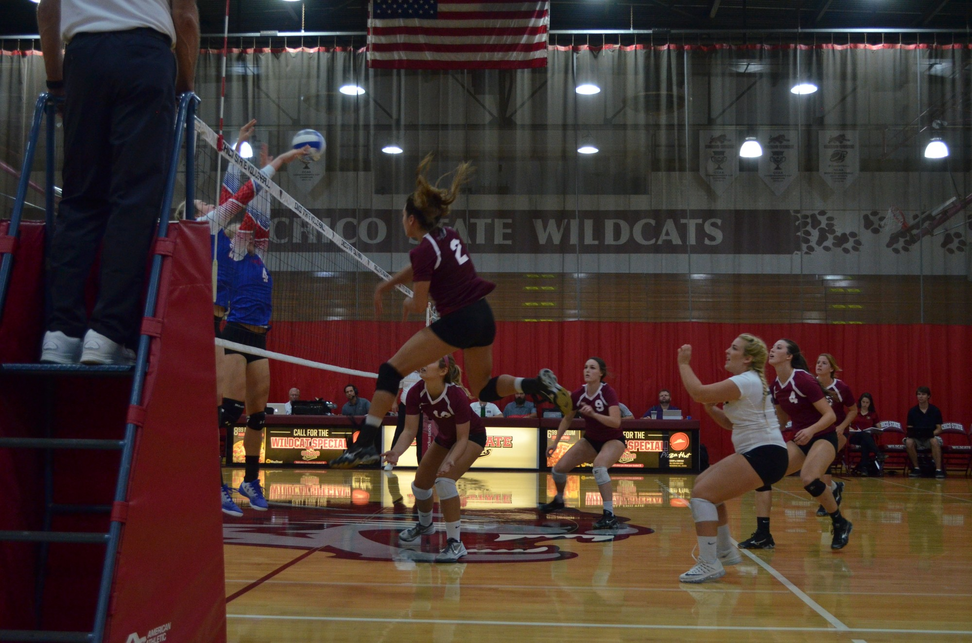 Olivia Mediano delivers a kill during the 'Cats preseason home game. Photo credit: Jordan Jarrell
