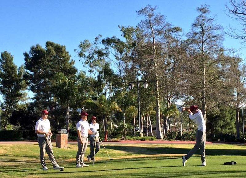 The Chico State men's golf team watches their teammate tee off during a Wildcat tournament. Photo courtesy of TL Brown