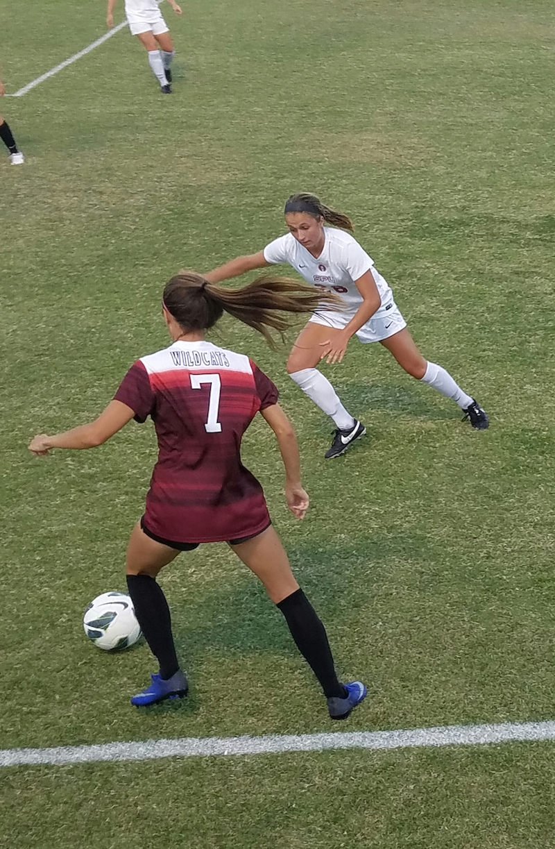 Chico State sophomore defender Korie Bozart dribbles the ball away from an opponent during the 'Cats home game. Photo credit: Jordan Jarrell