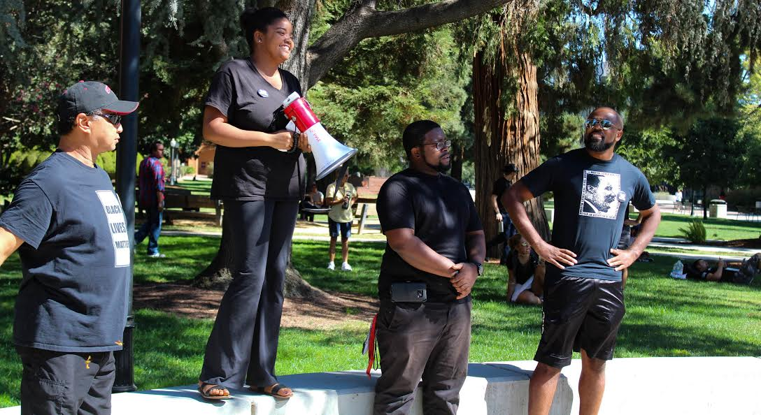 Chico State Faculty speak to students, faculty and alumni on Monday afternoon during the #BlackInChico protest at Trinity Commons. Photo credit: Jae Siqueiros