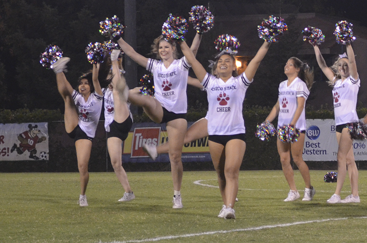 The+Chico+State+cheerleading+team+pumps+up+the+crowd+during+half+time.+Photo+credit%3A+Jordan+Jarrell