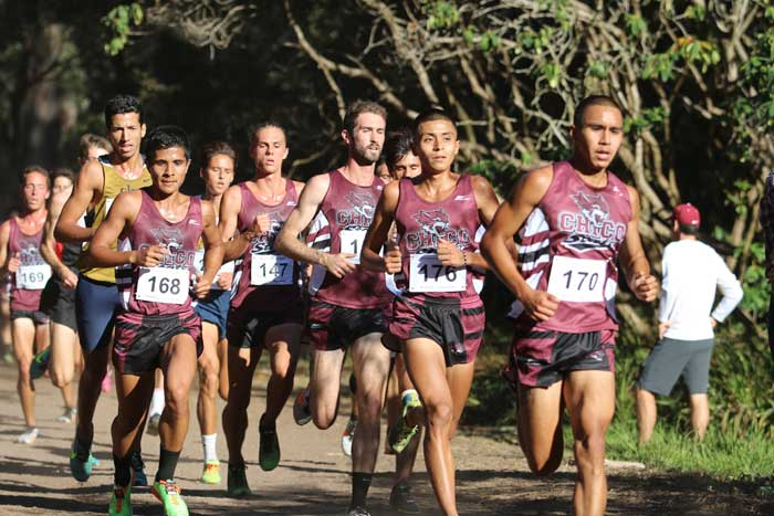 The men's cross country team runs as a group during their invitational. Photo courtesy of Gary Towne.