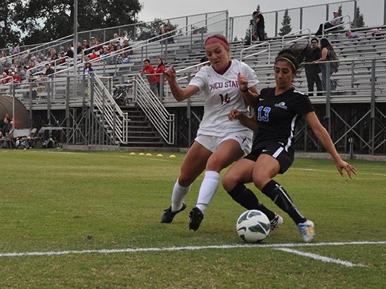 Sophomore Carlie Reader fights for the ball during the Cats home game against Cal State San Bernardino. Photo credit: Makayla Hopkins