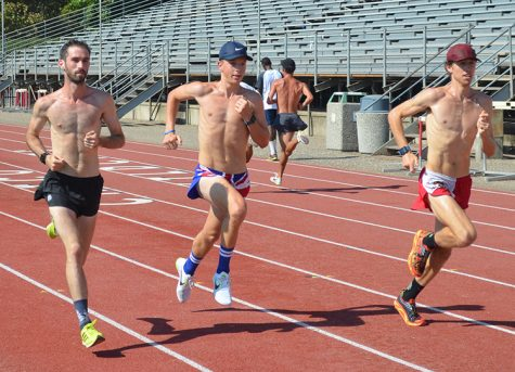 Junior Falco DiGiallonardo leads the men's cross country practice as they prepare for their upcoming tournament. Photo credit: Jordan Jarrell