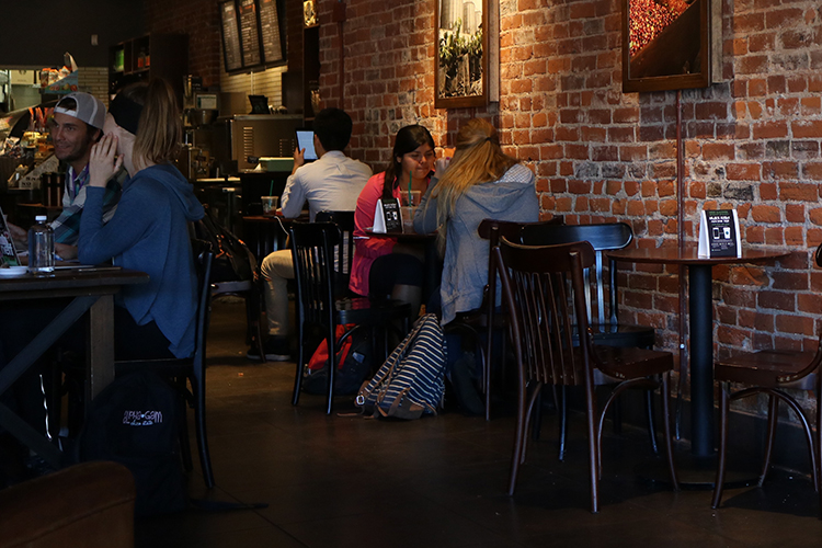 Students drinking coffee at the Starbucks on 246 Broadway St. Photo credit: Jovanna Garcia