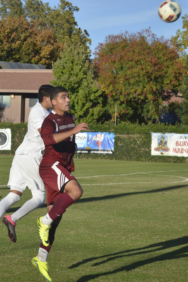 Senior forward Omar Nuno jumps to gain control of the ball against a defender. Photo credit: Jordan Jarrell