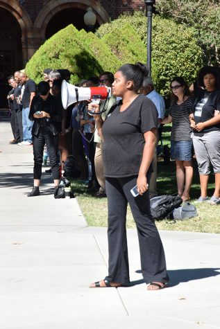 Egypt Howard speaks to the crowd during an awareness rally for Black Lives Matter. Photo credit: Royal T Lee-Castine