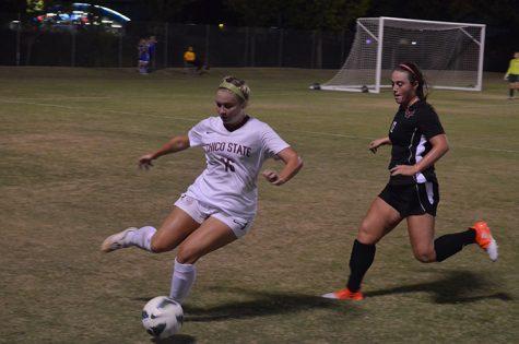 Brielynn Tovani juggles the ball away from a defender. Photo credit: Jordan Jarrell