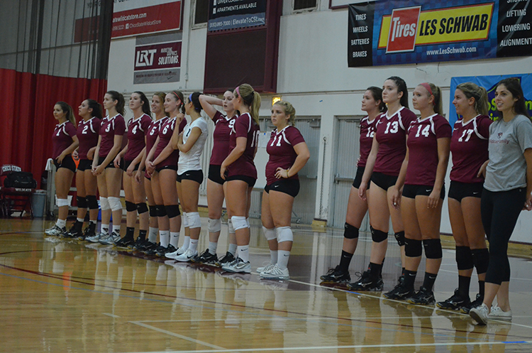 The+women%27s+volleyball+team+lines+up+before+their+game.+Photo+credit%3A+Jordan+Jarrell