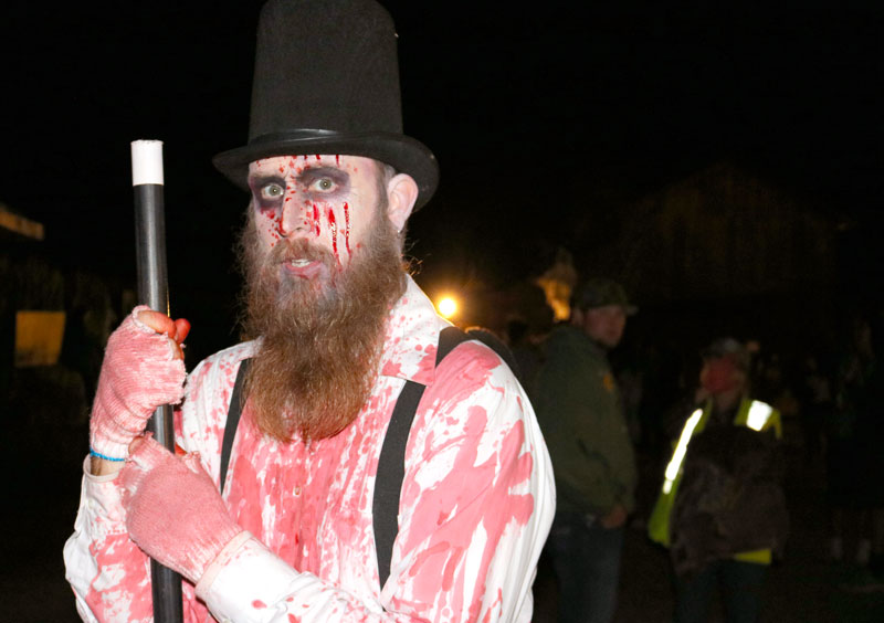 An actor is spotted at the entrance of the haunted corn maze. Photo credit: Matthew Manfredi