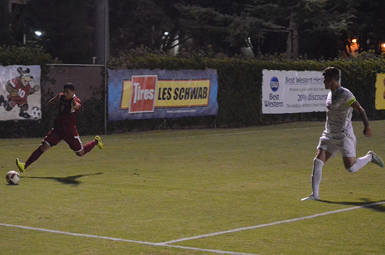 Omar Nuno drives the ball to the goalkeeper's box during a Chico State home game. Photo credit: Jordan Jarrell