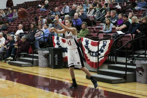 McKena Barker inbounds the ball during a Wildcat home game. Photo credit: Jordan Olesen