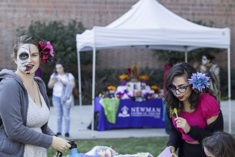 Junior communication major Amy Rodrigues (left), enjoys a Twizzlers at the outside portion of the event. A friend involved invited her to get her face painted while she was attending the event.  Senior Jessica Godinez (Right) helps a young attendee with some arts and  crafts at the second day of the event. As a transfer student from the Bay Area, Godinez didn't see much diversity when she first came to Chico. She was in culture shock and found Mecha. She loved what they stand for: social activism and bringing students together. Photo credit: Jordan Rodrigues