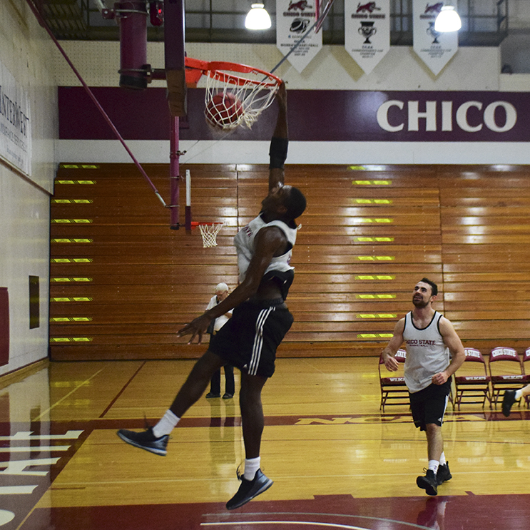 Junior forward Isaiah Ellis dunks during a Chico State scrimmage. Photo credit: Royal T Lee-Castine
