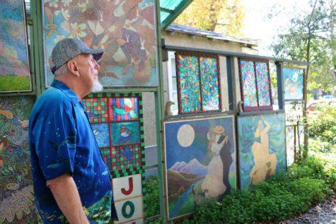 Norm Dillinger gazes at his art. Photo credit: Carin Dorghalli