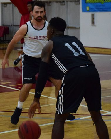 Junior guard Jalen McFerren dribbles against sophomore guard Joseph Lynch during a Wildcats scrimmage. Photo credit: Royal T Lee-Castine