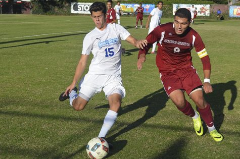 Senior forward Omar Nuno battles for the ball against a Sonoma State player. Photo credit: Jordan Jarrell