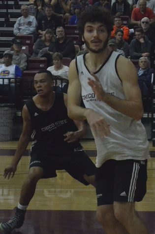 Corey Silverstrom attempts to free himself from a defender and get in position to receive an inbound pass. Photo credit: Jordan Jarrell