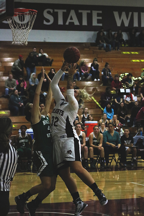 Junior forward Jo Paine attempts a shot at the rim. Photo credit: Jovanna Garcia