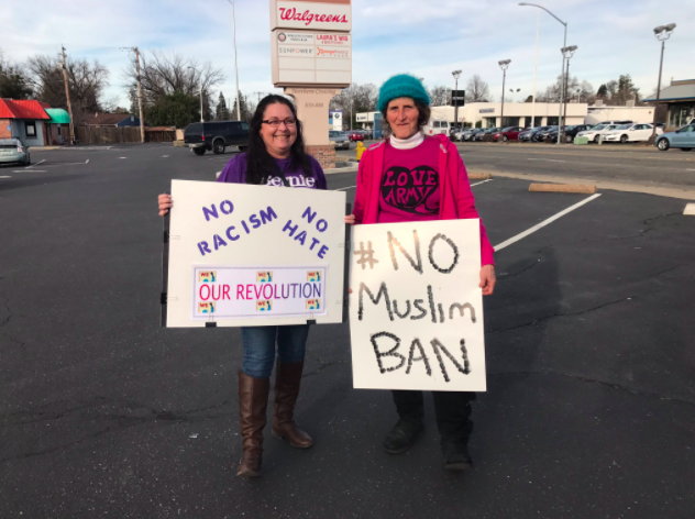 Robi Camacho (on the left) and Susan Sullivan (on the right) protesting against the immigration ban from President Donald Trump. Photo credit: Jafet Serrato