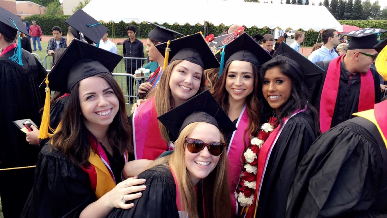 Students celebrating at the spring 2016 commencement ceremony. Photo credit: Ashley Narayan