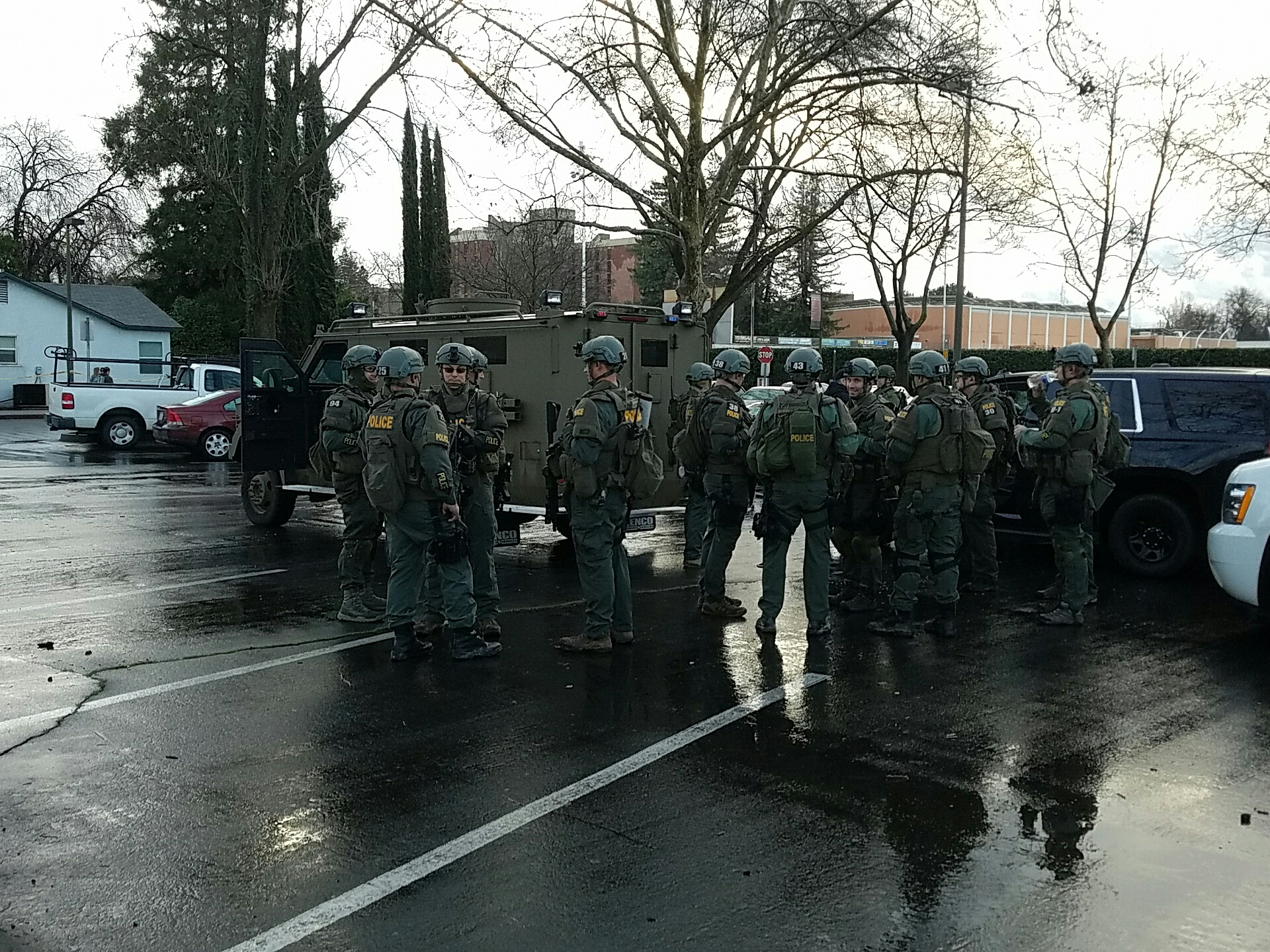SWAT team waiting to conduct raid. Photo credit: Daniel Wright