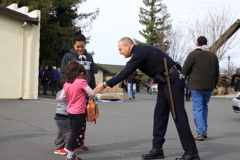 Chico Police Chief Mike OBrien helps Oroville evacuees at the Silver Dollar Fairgrounds. Photo credit: Miguel Orozco