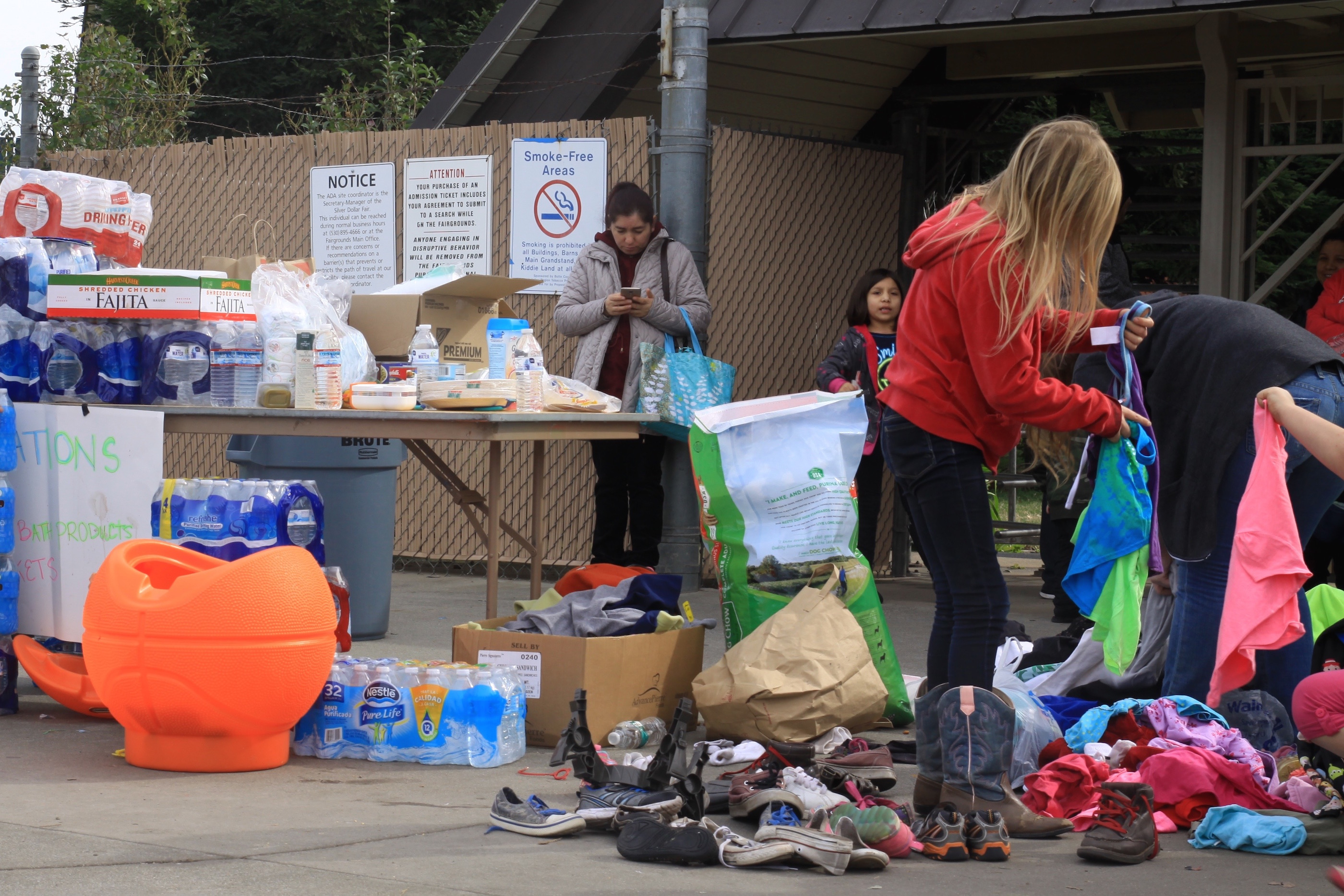 Many evacuees received donations from locals including clothing, shoes, and water. Photo credit: Miguel Orozco