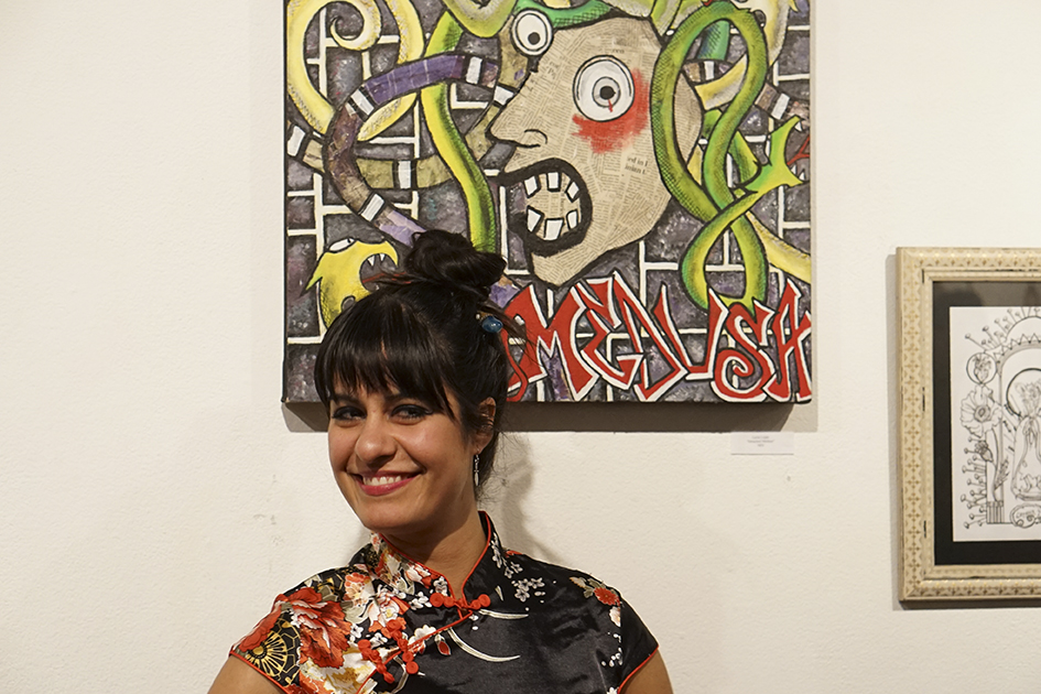 Lucia Lujan, Graphic Design major at Butte College posing with her Medusa piece at the Keep Chico Weird art show. Photo credit: Jordan Rodrigues