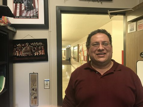 Dr. Vincent Ornelas smiles at the door of his office. Photo credit: Nicholas Feeley