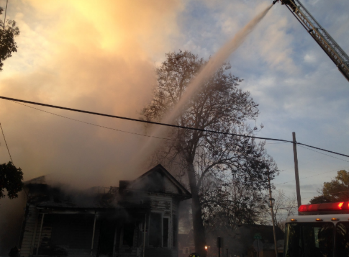 Chico Firefighters using all methods to tackle the fire on Chestnut and W. 7th street Photo credit: George Johnston