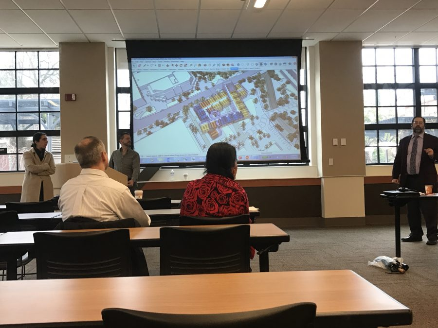 Roxanne Malek (far left) and Bill Katz (center) presenting certain sections of the proposed building. Photo credit: Jafet Serrato