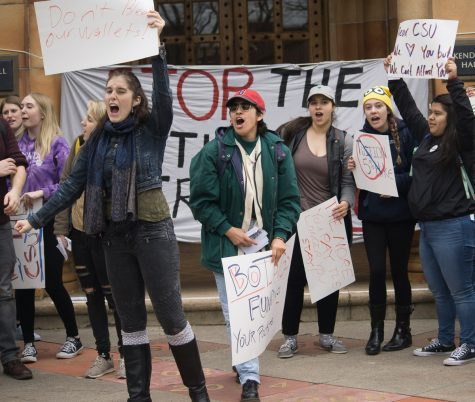 Chico State students protest the proposed tuition increase in front of Kendall Hall on Feb. 1. Photo credit: Carlos Islas