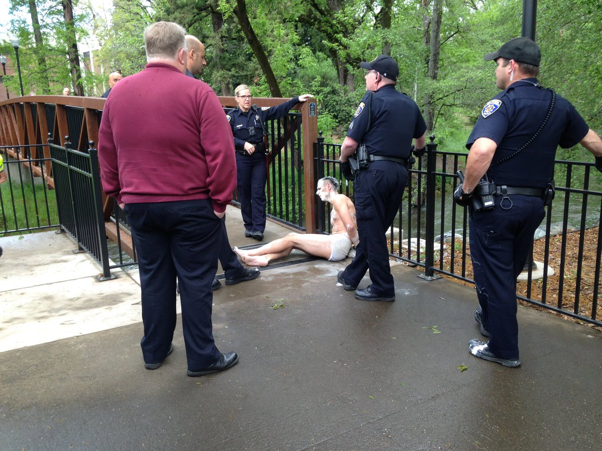 Man being apprehended for claiming he was the Easter Bunny. Photo credit: George Johnston