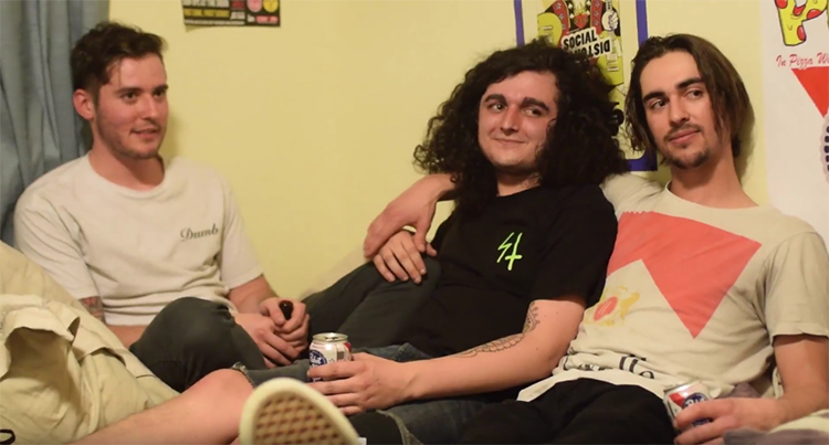 The members of Sunny Acres, Manuel Lopes (Left), Mike Justice (Middle), Jac Derner (right) cozy up on Jacs bed to talk about their latest house show with Oakland band Ice Cream. Photo credit: Miguel Orozco