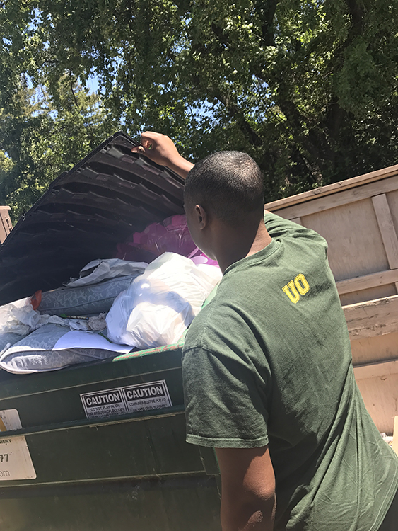 Chico State Student finds pillows in dumpster. Photo credit: Crystal Jinkens