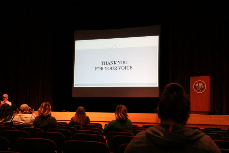 This slide shown during Take Back the Mic displays a simple yet powerful thank you to those who shared their experience through poetry. Photo credit: Carlos Gonzalez