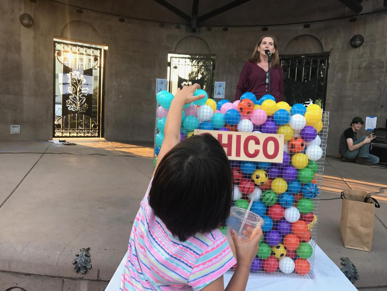 Little+girl+places+ball+in+community+basket.+Photo+credit%3A+Christian+Solis