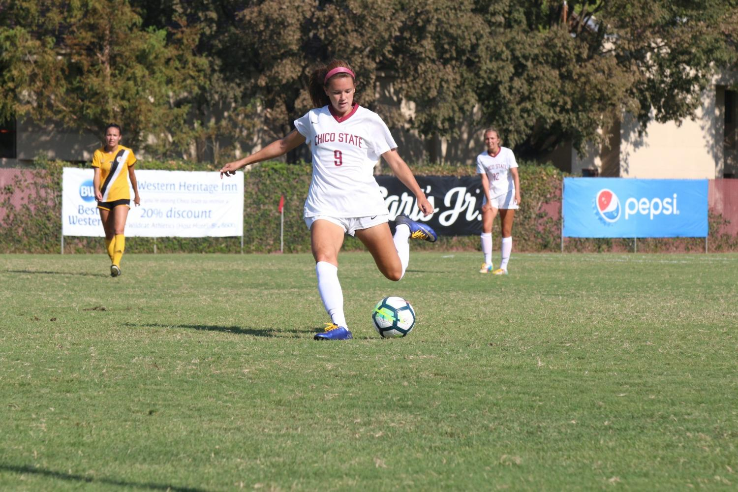Junior forward Korie Bozart kicks the ball after a stoppage in play. Photo credit: Lamar Lomack