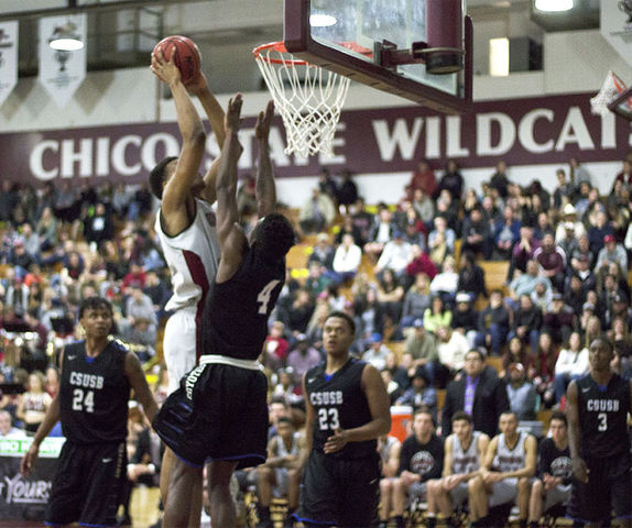 Sophomore forward Justin Briggs goes up for a poster dunk over a Cal State San Bernadino defender. Photo credit: Jordyn Smith