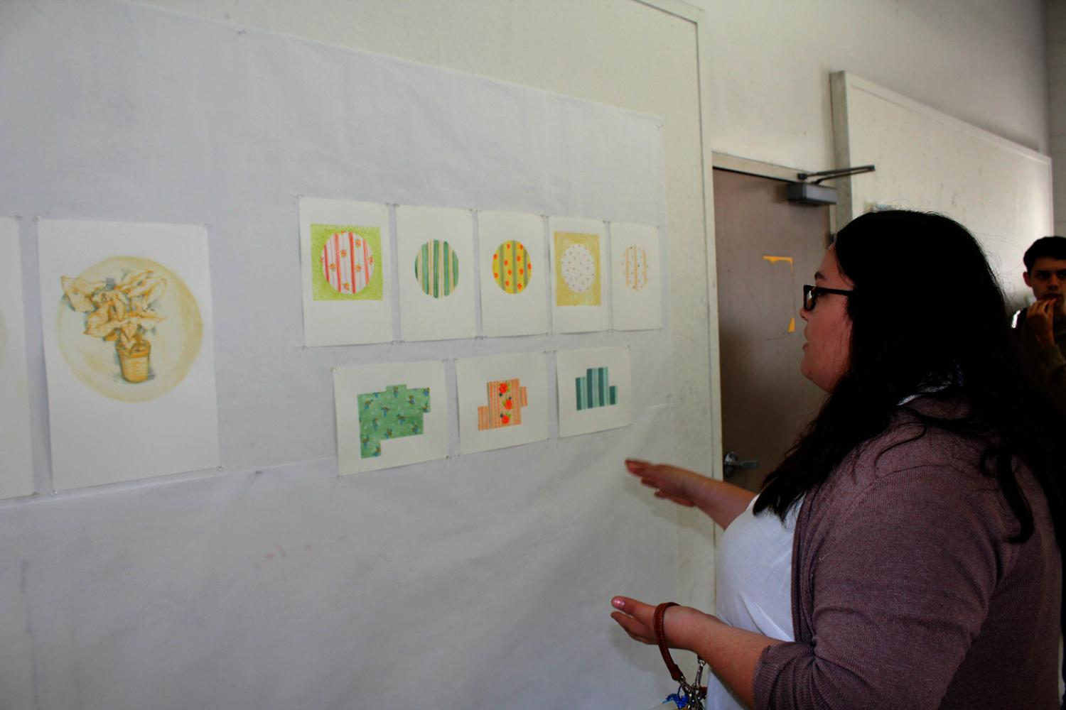 Artist Marie Fox talks about her prints, telling us she was trying to create the look of embroidery in all her art. She wanted the shapes to resemble floor plans in the bottom row. Photo credit: Abigail Jones