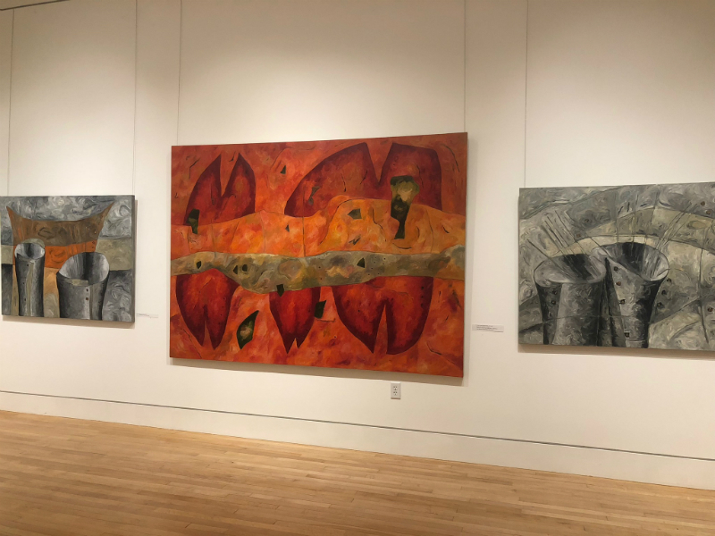 """Large-scale paintings left untitled, except for the one in the center, which is called """"Big Trinity River."""""""